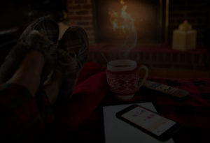 relaxing in front of a fire with a cup of coffe