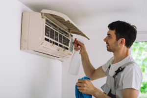 man fixing air conditioner