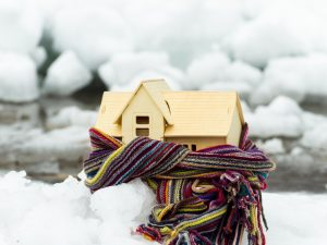 warm house with scarf around it